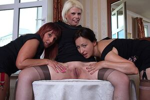 Three piping hot mature ladies getting wet on the couch